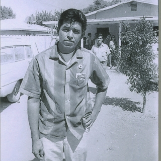 YOUNG STRIKER ROBERTO BUSTOS LEAVING A MEETING FOLLOWED BY CESAR CHAVEZ IN BACK.