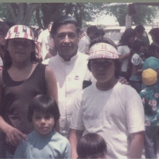 SONS OF ROBERTO BUSTOS WITH CESAR CHAVEZ AT A DELANO RALLY - ROBERTO,JR., RICHARD, CESAR, AND MIGUEL.