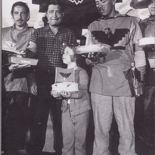 AT ONE OF THE NIGHT RALLIES THE MARCHERS WERE TREATED WITH FOOD AND SWEETS. HERE JORGE ZARAGOZA, CESAR CHAVEZ AND MARCH CAPTAIN ROBERTO BUSTOS WERE HANDED A CAKE BY A YOUNG GIRL.