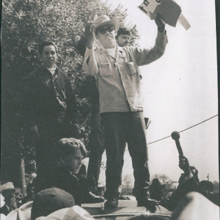 CAPTAIN ROBERTO BUSTOS ANNOUNCING ON APRIL 6, 1966 THE SIGNING OF SCHENLEY INDUSTRIES UNION CONTRACT THAT WAS AGREED TO DURING THE MARCH TO SACRAMENTO. OUR FIRST CONTRACT, 25 MORE TO GO!
