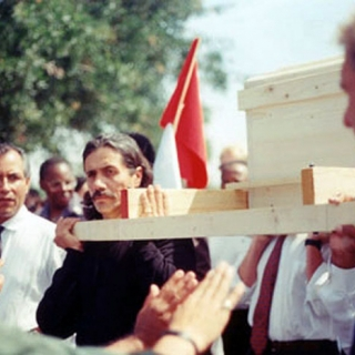 Funeral of Cesar Chavez April 1993. Edward Olmos and Joe Kennedy carry Cesar\'s casket.
