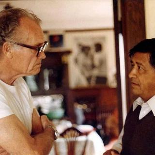 Fred Ross and Cesar Chavez at the offices of United Domestic Workers in San Diego 1980.