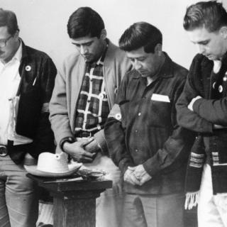 Cesar Chavez / Praying / Photo by Jon Lewis
