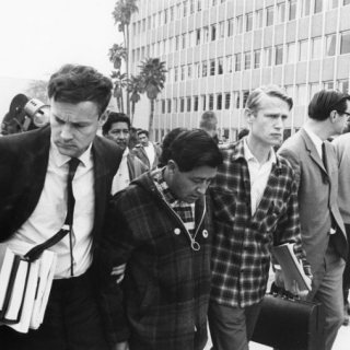 WITH JERRY COHEN ESCORTING CESAR CHAVEZ FROM KERN COUNTY COURT HOUSE