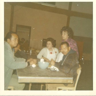 UFW officials, Pete Velasco & Larry Itliong, with Parlier members. / c. 1969